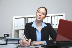 Woman in the office makes a note Stock Images