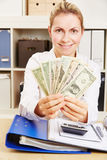 Woman in office with many Dollar money bills Stock Image
