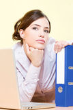 Woman in office near laptop and file Royalty Free Stock Photos