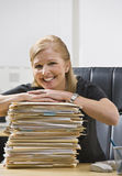 Woman in Office with Paperwork Royalty Free Stock Photos