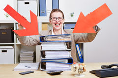 Woman in office pointing arrows Royalty Free Stock Photos