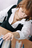 Woman in office search a file Royalty Free Stock Photos