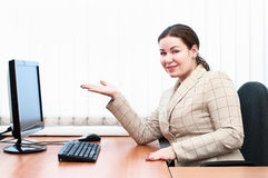 Woman in office showing at monitor Royalty Free Stock Image