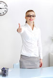 Woman in the office showing okay gesture. Stock Photography