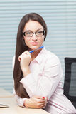 Woman at office. Smart and intelligent girl at office Royalty Free Stock Photo