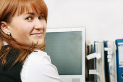 Woman in office smiling. Woman smiling At work in the office royalty free stock photo