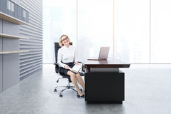 Woman in an office Royalty Free Stock Photos