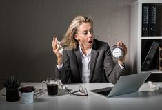 Woman at office in stress about deadline stock photo