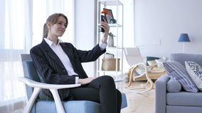Woman in Office Taking Selfie on Smartphone royalty free stock photo