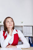 Woman in office thinking. Attractive woman in office thinking and looking up Royalty Free Stock Photo