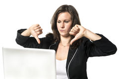 Woman in office with thumbs down Stock Image