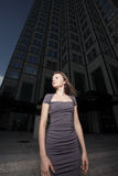 Woman by an office tower Stock Photos