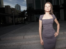 Woman by an office tower Royalty Free Stock Photos