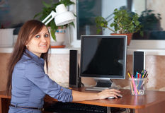 Woman in office using computer Royalty Free Stock Image