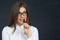 Woman office worker close up face portrait  with pen. Glasses wearing businesswoman Stock Photo