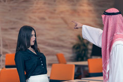 Woman office worker gets fired by arab businessman Stock Images