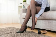 Woman office worker getting ankle hurt problem royalty free stock images