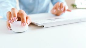 Woman office worker typing on the keyboard. Business concept stock video footage