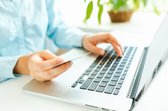 Woman office worker typing on the keyboard Royalty Free Stock Images