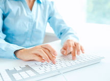 Woman office worker typing on the keyboard Stock Photos