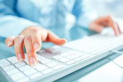 Woman office worker typing on the keyboard Royalty Free Stock Photo
