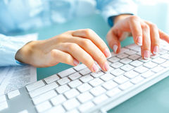 Woman office worker typing on the keyboard Royalty Free Stock Image
