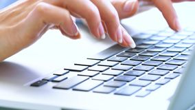 Woman office worker typing on the keyboard stock footage