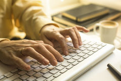 Woman office worker typing on the keyboard. Manager. Royalty Free Stock Image