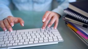 Woman office worker typing on the keyboard and works with taxes stock video