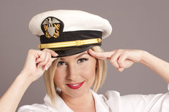 Woman in officers cap. Woman wearing generic officers cap saluting stock image