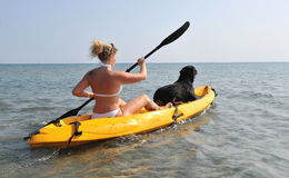 Woman and og on a kayak Royalty Free Stock Photos