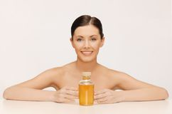 Woman with oil bottle Stock Photography