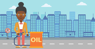 Woman with oil can and filling nozzle. An african-american woman standing beside the oil can and holding filling nozzle on a city background vector flat design Stock Image
