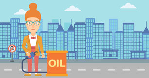 Woman with oil can and filling nozzle. A woman standing beside the oil can and holding filling nozzle on a city background vector flat design illustration Stock Photos