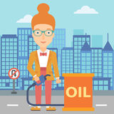 Woman with oil can and filling nozzle. A woman standing beside the oil can and holding filling nozzle on a city background vector flat design illustration Stock Image
