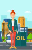 Woman with oil can and filling nozzle. A woman standing beside the oil can and holding filling nozzle on a city background vector flat design illustration Royalty Free Stock Photos