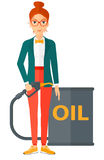 Woman with oil can and filling nozzle. A woman standing beside the oil can and holding filling nozzle vector flat design illustration  on white background Stock Images