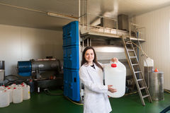 Woman in oil extracting section Royalty Free Stock Photo