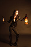 Woman with oil lamp Stock Photography