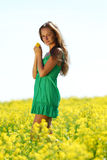 Woman on oilseed field Royalty Free Stock Photos