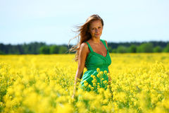 Woman on oilseed field Stock Images