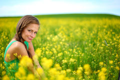Woman on oilseed field Stock Photo