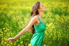 Woman on oilseed field Stock Photo