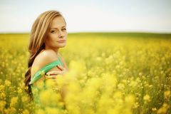Woman on oilseed field Stock Image