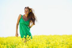 Woman on oilseed field Royalty Free Stock Image