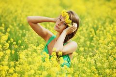 Woman on oilseed field Royalty Free Stock Photography