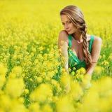 Woman on oilseed field Stock Photos