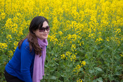 Woman and oilseed rape flower Royalty Free Stock Photography