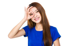 Woman with ok gesture on eye Stock Images