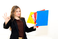 Woman with OK gesture and folder. Smiling woman with OK gesture and folder on white background Stock Image